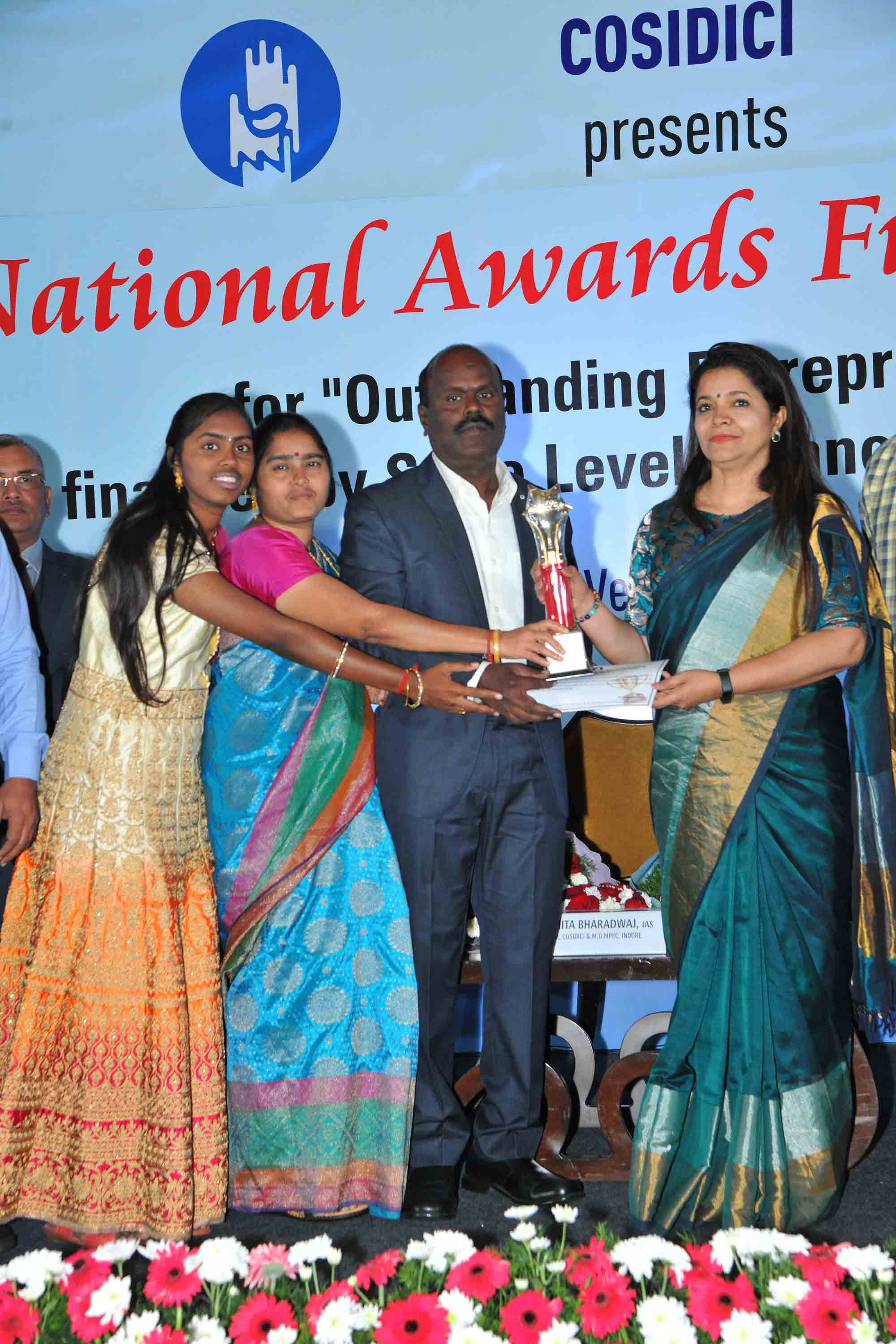 - Promoter of Excellent Hi-Care Pvt Ltd ,Villupuram, receiving Best First Generation Entrepreneur Award from COSIDICI during its National Awards 2019 Program held at Bengaluru